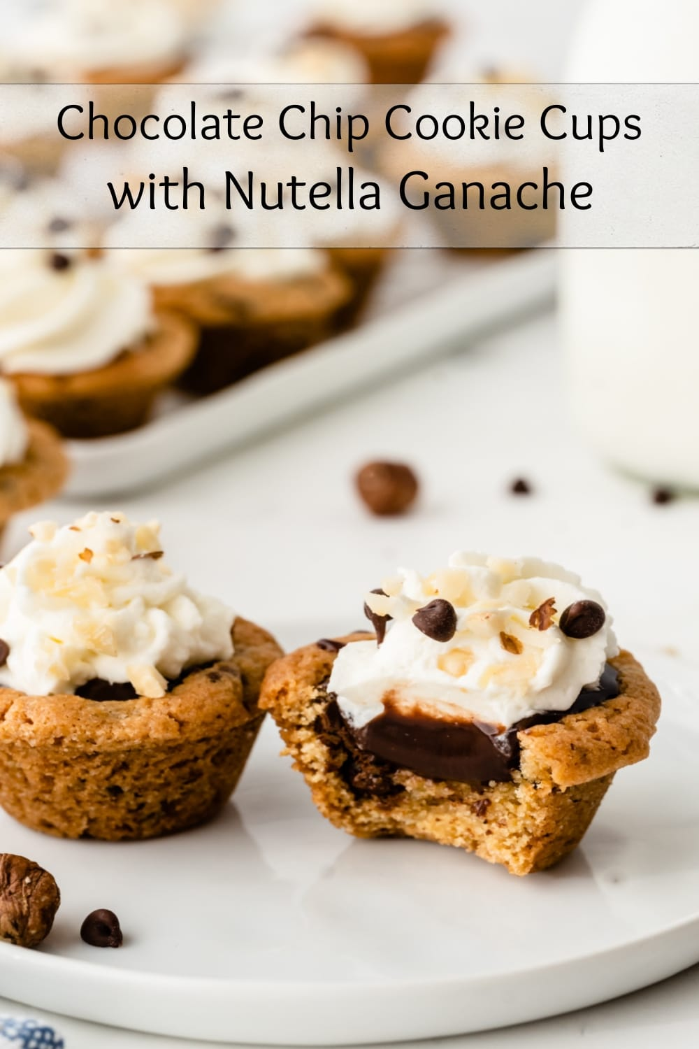 Chocolate Chip Cookie Cups filled with a simple to make Nutella ganache and topped with whipped cream, the perfect sweet treat when that chocolate craving hits. via @cmpollak1