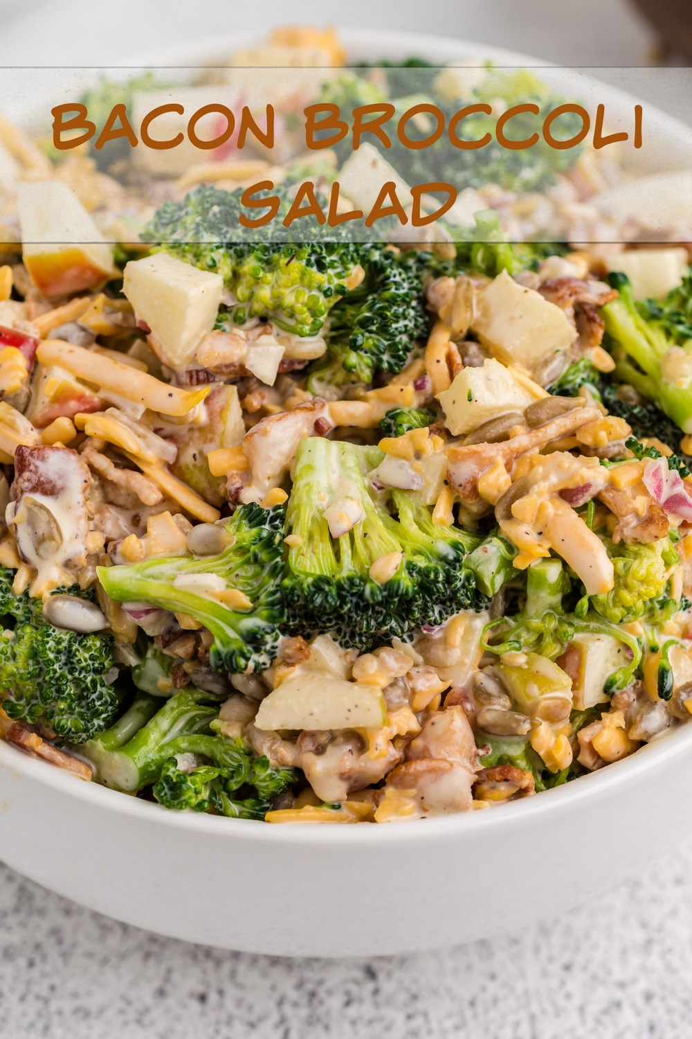 Bacon Broccoli Salad is full of fresh ingredients like broccoli florets and crunchy apple and packed with crispy bacon and sunflower seeds. A light and tangy dressing pulls it all together. via @cmpollak1