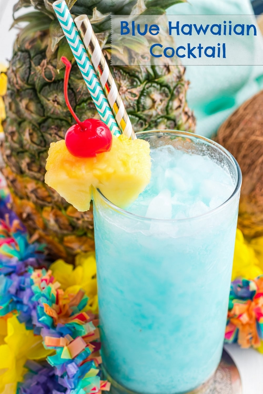 This Blue Hawaiian cocktail tastes like a vacation in a glass. Notes of pineapple, coconut and citrus from the Blue Curacao liqueur make it the perfect tropical cocktail for summer parties! via @cmpollak1