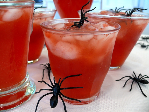 Red Blood Punch - ThisFrightening Blood Red Punch is simple to make with a few ingredients and frozen fruit! Plus you can add in homemade spider ice cubes for a fun Halloween look!