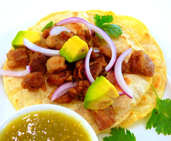 The Best Pork Carnitas are so easy to make they are perfect for a weeknight dinner. Make them for Cinco de Mayo for a delicious, authentic meal. #noblepig #carnitas #tacos #mexican #pork